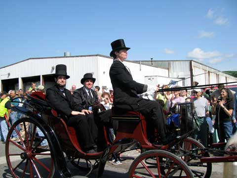 Lincoln riding in Carriage